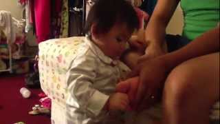 Baby tries to bite daddy's toe