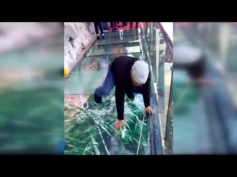 Tourist terrified by new glass walkway that cracks under wei