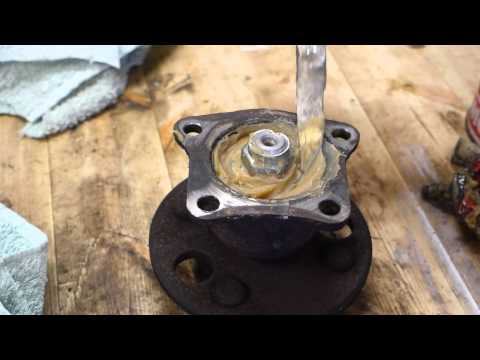 How to add grease to wheel bearings rear Toyota Corolla. Years 1991 to 2002.