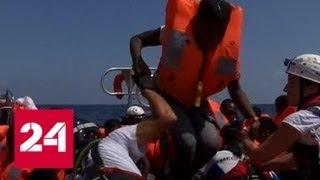 Смотреть видео В Средиземном море спасли 141 беженца из Ливии - Россия 24 онлайн