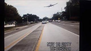 Police Dashcam Captures Plane Crashing Onto Road