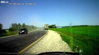 Driver just misses death after a SUPER close call with an oncoming 18-wheeler semi truck