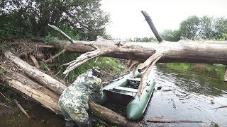 FISHING IN THE TAIGA RIVER. ALLOY BOAT . THE PIKE FISHING.