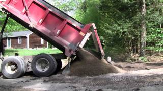 International 7400 Dump Truck Dumping Gravel