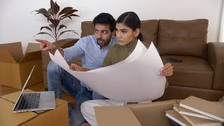 Shifting to new house - Indian couple planning their house relocation and discussing house drawings