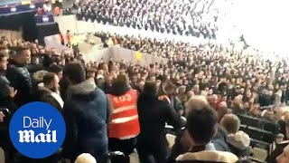 Download Video Fist fight breaks out as Spurs fan discovered in West Ham end MP3 3GP MP4