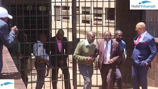 President Robert Mugabe son in law Simba Chikore sneaking out of Harare Magistrate Court
