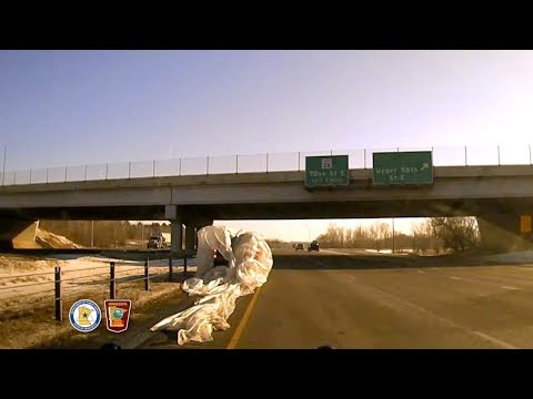 MSP Dashcam: Unsecure Sheet Of Plastic Engulfs SUV On Highway 52