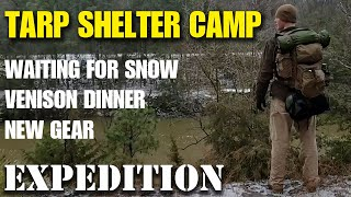 Heated tarp shelter overฑight camp in freezing weather