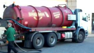 Vacuum Tanker Collecting Used Oil At KFC