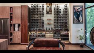 Modern Wine Cellar featuring Cable Wine System, 'Reach-In, Surrounding Glass Design'