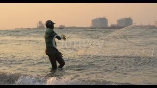 Fisherman throwing fishnet indian ocean sunset closeup of sea waves Slow motion | Stock Video
