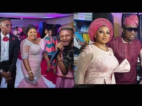 Ayo Adesanya dancing with her son as Pasuma snaps with Mide Martin on her 50th birthday party.