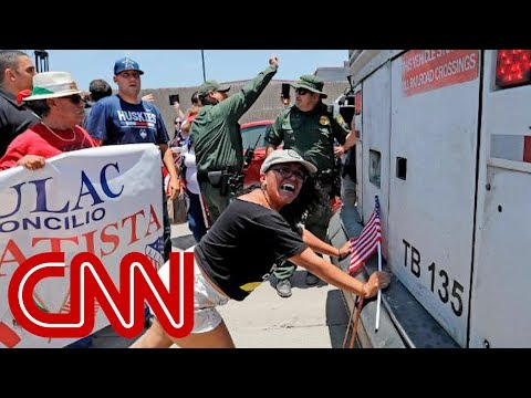 Protesters block bus at immigration site