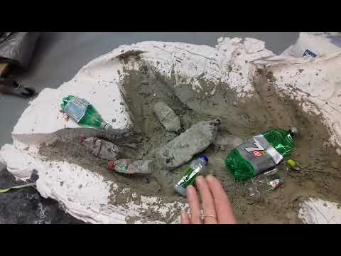 Making a body cast adding wire and plastic bottles