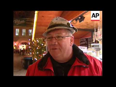 Christmas market visitors in Berlin accepts the old German currency