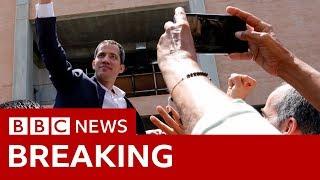 Juan Guaidó flies back to Venezuela amid arrest risk - BBC News