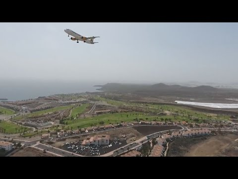 British bloke films landing airplanes from closeby with a drone on Tenerife South Airport.