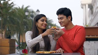 Cute Indian guy feeding yummy pizza to his girlfriend on Valentine's day in India