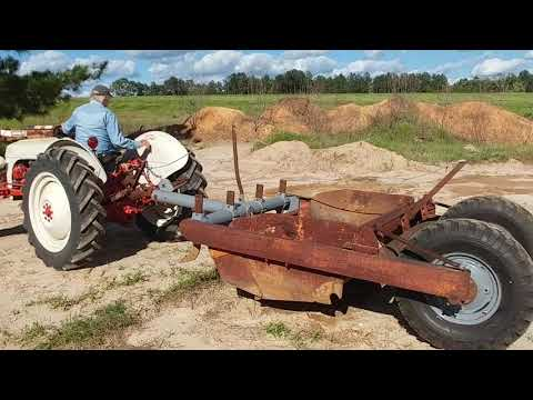 Overland scraper and 8n Ford tractor