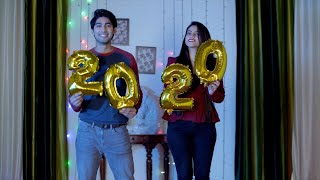 Young friends holding 2020 foil numerals during New Year celebrations in India