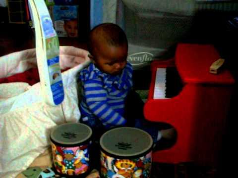 Jordan, AfroAsian infant girl, playing piano