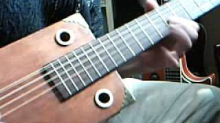 My new home made 6 string acoustic/electric CBG Cigar Box Guitar
