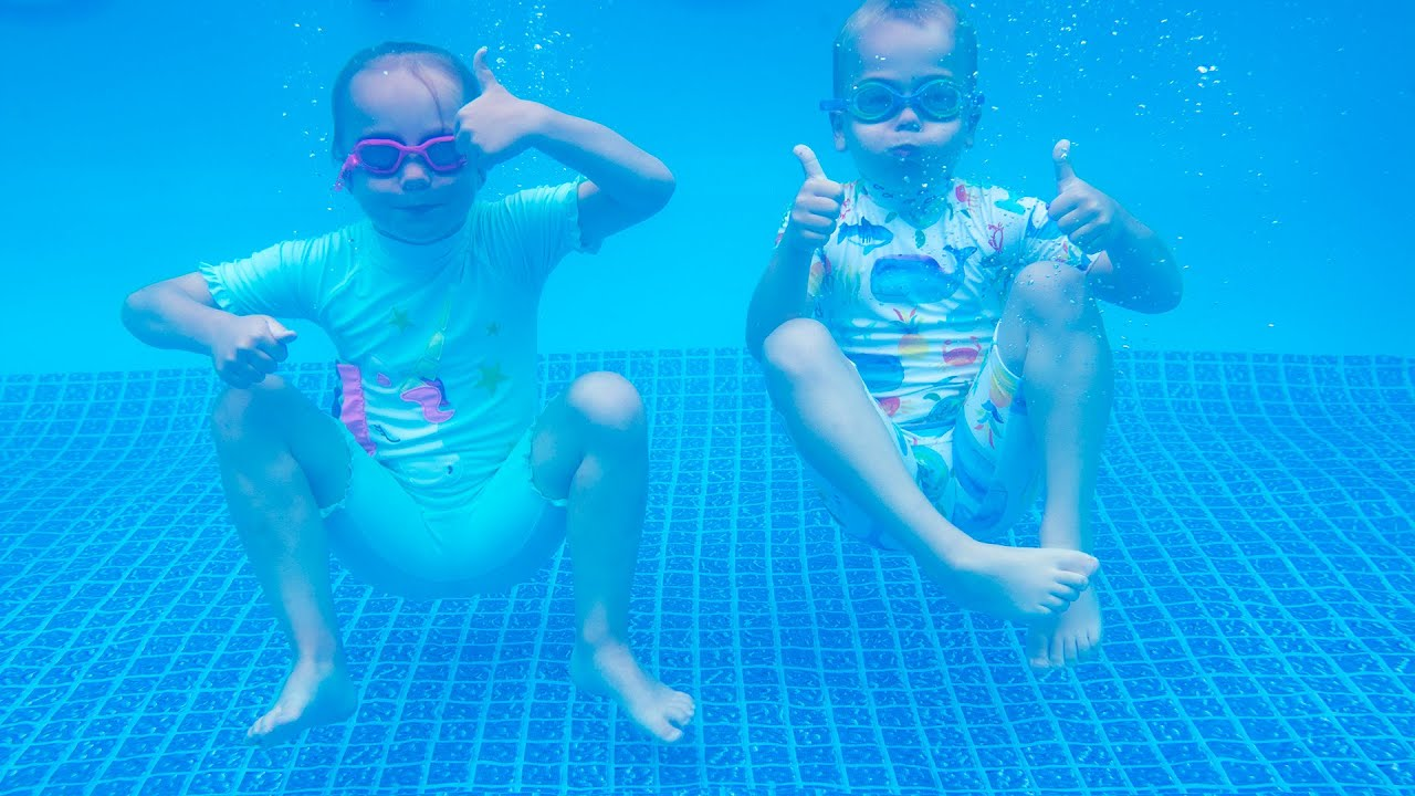 Download Gaby and Alex learning how to swim and having fun in a swimming pool