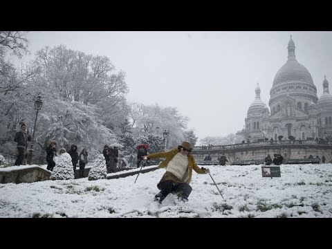 France: Eiffel Tower forced to close as snow blankets Paris