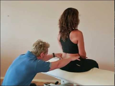 How to assess for Sacroiliac Joint (SIJ) motion during forward bending