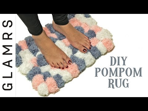 If you wanted to make something soft to stand on, watch out this pom pom rug making tutorial. woolen thread mat designs, DIY pom pom floor mat with wool, Pom Pom Rug