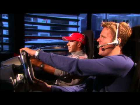 Lewis Hamilton plays Codemasters' F1 2010 game