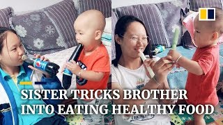 Download Sister tricks younger brother into eating healthy food in China