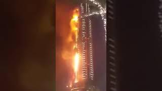 A massive fire in Dubai against the Burj Khalifa