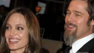 angelina jolie brad pitt sweet kiss clooney s charity ball