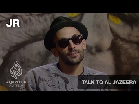 Guerrilla Artist JR - Talk to Al Jazeera