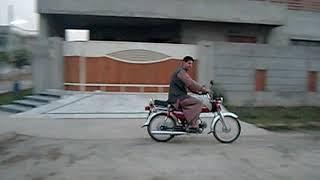 Driving Yamaha Motorbike in Lahore Pakistan