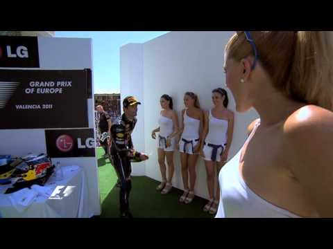 Mark Webber playing jokes with pit girls in Valencia