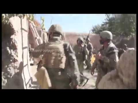 U.S. Marine soldiers running to safe zone behind wall in War in Afghanistan archival stock footage