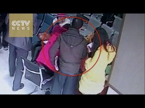 Smooth crook swipes woman's handbag at a bank
