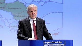 EU's Rehn warns Germany over trade surplus