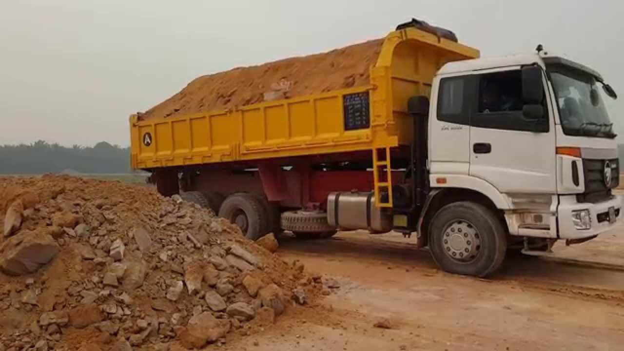 Dump Truck Unloading Sand N Rock