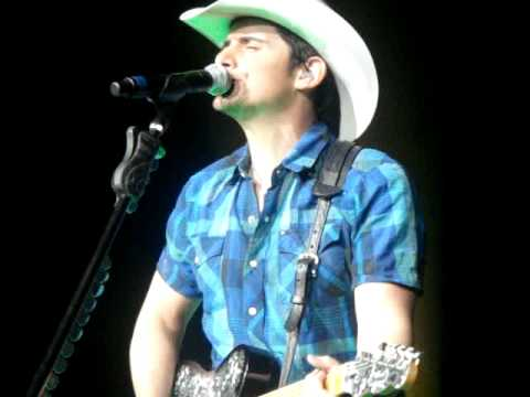 Aaron Rodgers on stage with Brad Paisley Frozen Over H20 Tour