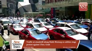 Traffic at standstill along Bukit Bintang as cabbies stage protest against Uber, Grab