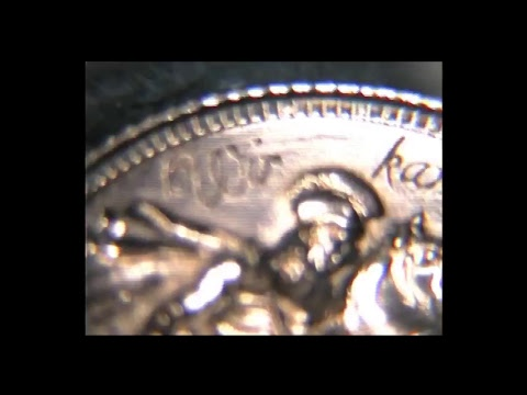 Hand engraving script lettering on a Gold Sovereign Coin