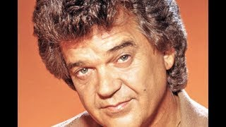 Conway Twitty - Between Her Blue Eyes And Jeans YouTube Videos