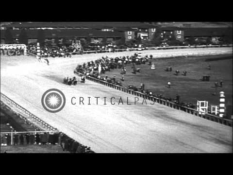 Spectators in a stand watch Washington Handicap horse race as War Admiral wins th...HD Stock Footage