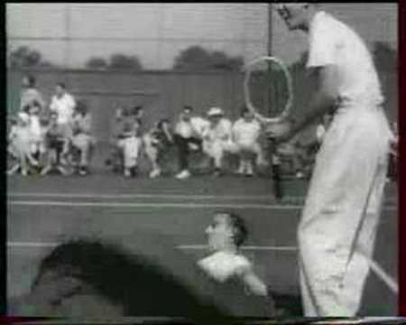 Charlie Chaplin playing tennis