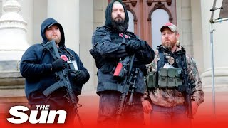 Armed protesters in Michigan storm governor's statehouse demanding end to coronavirus lockdown
