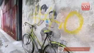 Famous Penang wall art vandalised with yellow paint